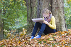 Girl drawing in the park Stock Images