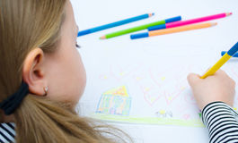 Girl drawing with pencils. Closeup portrait of girl drawing with colorful pencils Stock Photography