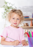 Girl drawing with pencils Stock Photography