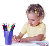Girl drawing with pencils Stock Photos