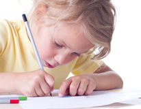 Girl drawing with pencils Royalty Free Stock Photography