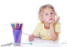 Girl drawing with pencils Royalty Free Stock Images