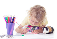 Girl drawing with pencils Stock Image