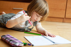 Girl drawing with pencils Stock Photo