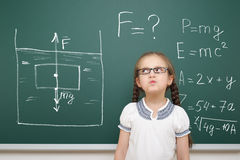 Girl drawing physical phenomenon gravity on board Royalty Free Stock Photography