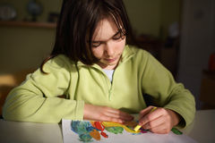 Girl drawing picture Stock Image