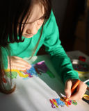 Girl drawing picture Royalty Free Stock Images