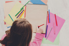 Girl drawing picture with colored pencils and Royalty Free Stock Photography