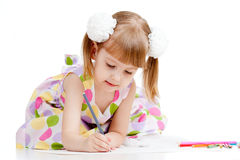 Girl drawing a picture with colour pencils Stock Photos