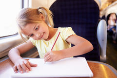 Girl Drawing Picture On Train Journey Royalty Free Stock Image