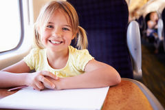 Girl Drawing Picture On Train Journey Stock Photo