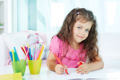 Girl drawing Royalty Free Stock Photos
