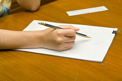 A girl is drawing a rose on a pile of paper. For Valentine's event royalty free stock photo