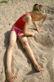 Girl drawing in the sand royalty free stock photos