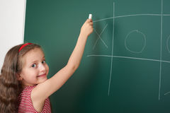 Girl drawing on school board Stock Photography