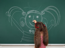Girl drawing on school board Stock Image
