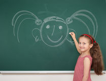 Girl drawing on school board Stock Photo