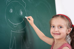 Girl drawing on school board Stock Photos