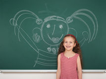 Girl drawing on school board Royalty Free Stock Photos