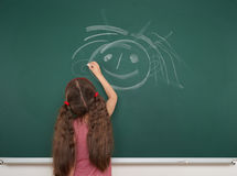 Girl drawing on school board Royalty Free Stock Photo
