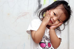 A girl with drawing on the wall Stock Image
