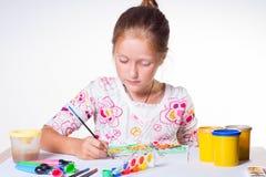 Girl drawing Stock Photos