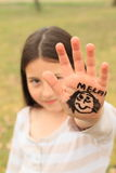 Girl with drawings on hand Royalty Free Stock Photos