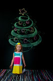 The girl and the drawn tree Royalty Free Stock Photography