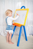 Girl draws Stock Photo