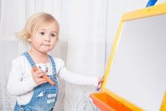Girl draws Stock Photos