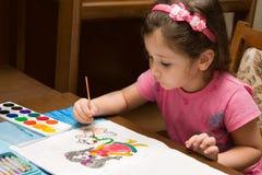 The girl draws Stock Photos