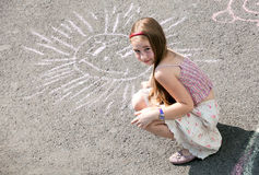 Girl draws on  asphalt Stock Photos