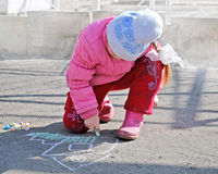 Girl draws chalk Stock Photography