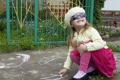 Girl draws a chalk Royalty Free Stock Photos