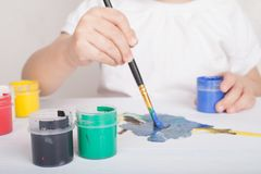 Girl draws in color paints royalty free stock photo
