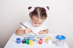 Girl draws in color paints. Portrait royalty free stock image