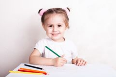 The girl draws in colored pencils. Portrait stock image