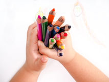 Girl draws with colored pencils Royalty Free Stock Photo