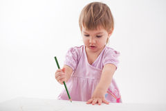 Girl draws with crayons Stock Photo