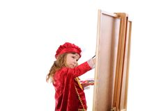 Girl draws on easel. Stock Photo