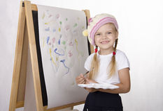 Girl draws on the easel Royalty Free Stock Image