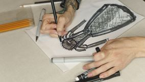 Girl fashion designer draws sketch evening dress. Girl draws fashion sketch of an evening dress. Shooting close-up. She paints with markers royalty free stock photos