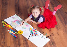 The  girl draws on a floor Royalty Free Stock Photography