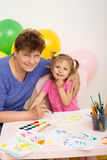 A girl draws with her grandmother Royalty Free Stock Photography