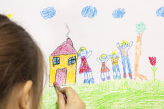 Girl draws her own house Royalty Free Stock Images