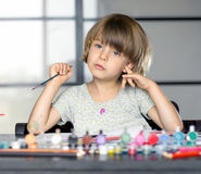 Girl draws. Little girl draws by paints Royalty Free Stock Image