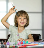 Girl draws. Little girl draws  by paints  with inspiration Stock Photography