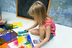 Girl draws Stock Images