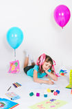 The girl draws lying on a floor Royalty Free Stock Images