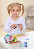 The girl draws with markers Royalty Free Stock Photos